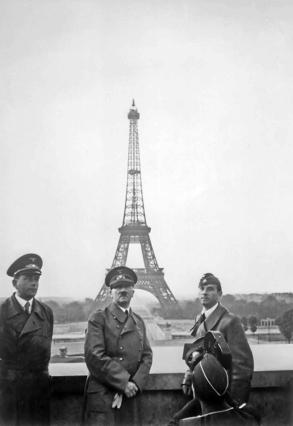 Adolf Hitler in front of the Eiffel Tower, Paris.